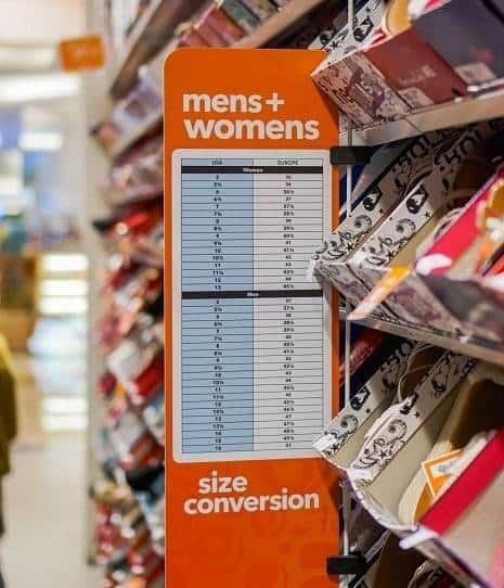 Beside of shoe rack Men and Women Size Conversion chart