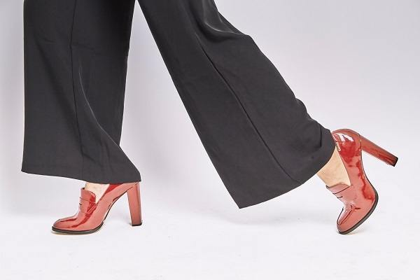 Women walking with red heel for checking foot are sliding forward or not