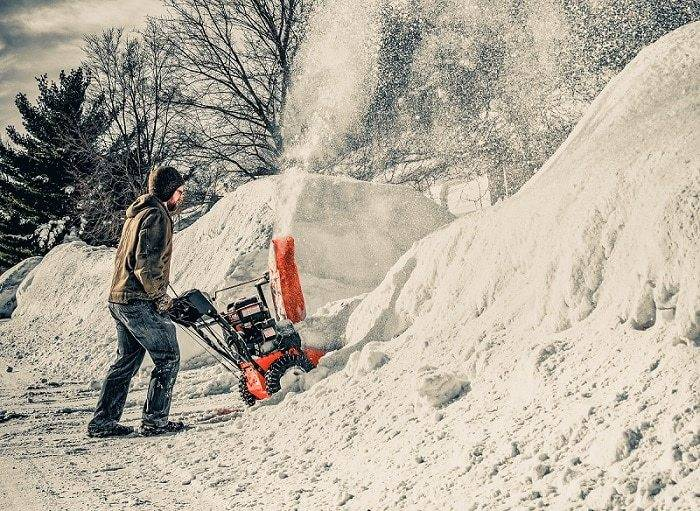a man work on snow with protect feet by boots