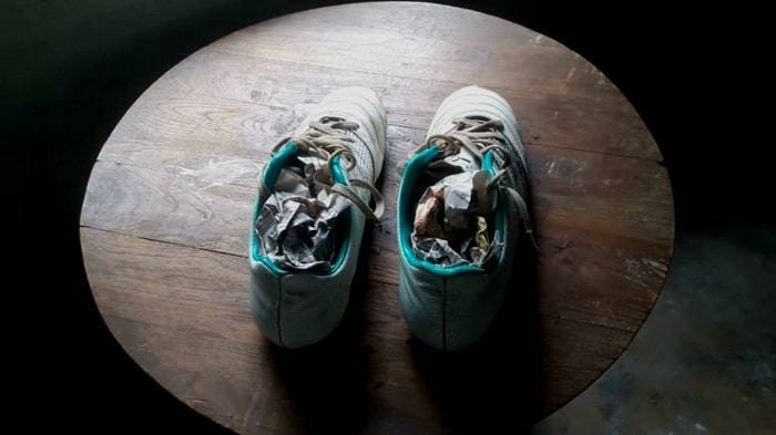 newspaper remedy on shoes to absorb humidity