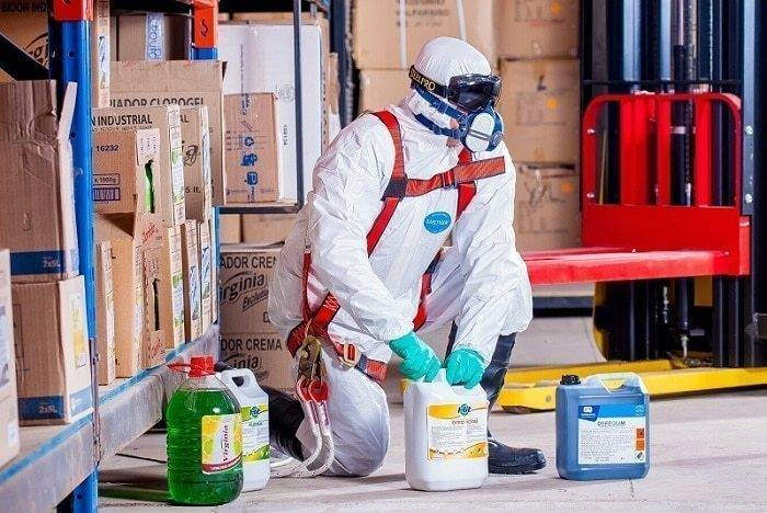 protect full body with suit gloves goggles and boots in chemicals factory