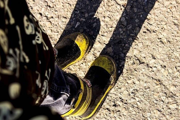yellow and black rubber footwear for work slippery workplace