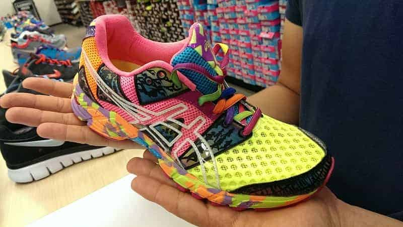 compatible cushioning for better performance- a runner checking cushioning before buying Running shoes